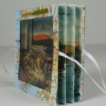 A tunnel book made with vintage maps and postcards